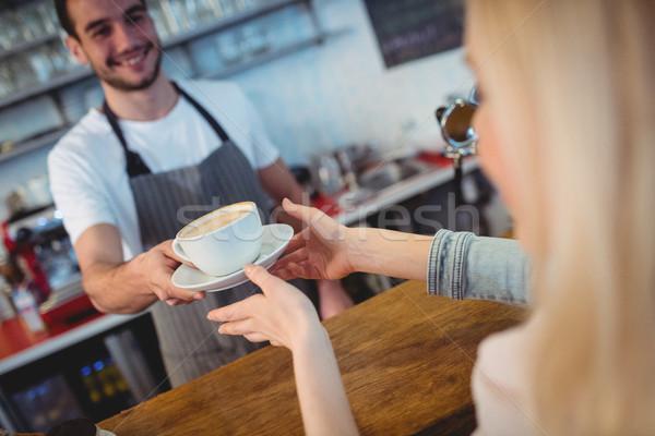 Tilt shot of barista serving coffee to woman at cafe Stock photo © wavebreak_media