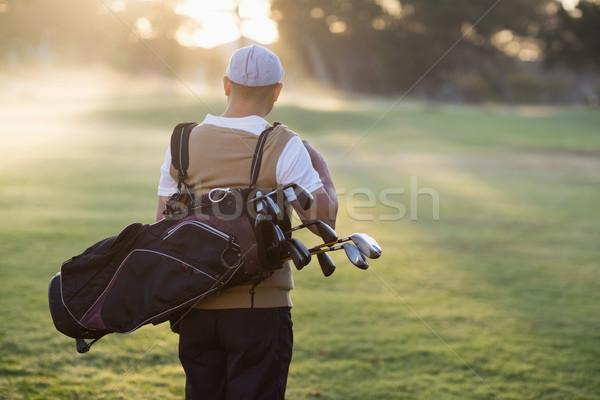 ストックフォト: 背面図 · 男 · ゴルフバッグ · 立って · フィールド