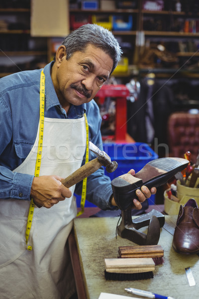 Portrait of shoemaker hammering on a shoe Stock photo © wavebreak_media