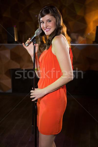 Woman singing in bar Stock photo © wavebreak_media