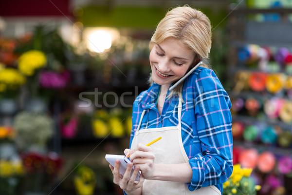 Feminino florista ordem telefone móvel Foto stock © wavebreak_media