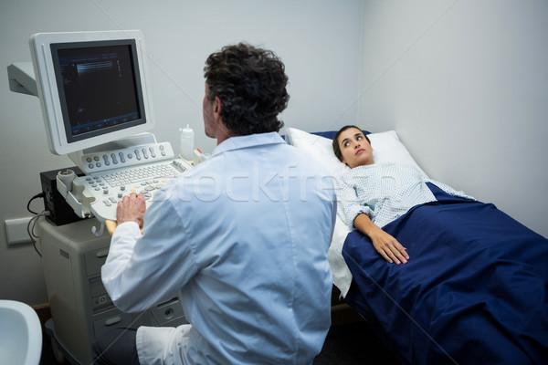 Doctor using sonography machine Stock photo © wavebreak_media