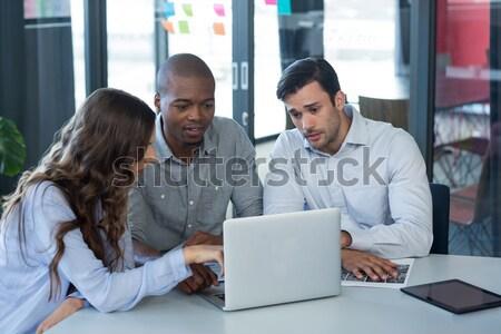 Graphic designers working on computer at desk Stock photo © wavebreak_media
