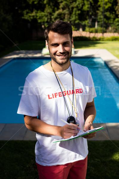 Retrato salvavidas escrito portapapeles hombre Foto stock © wavebreak_media
