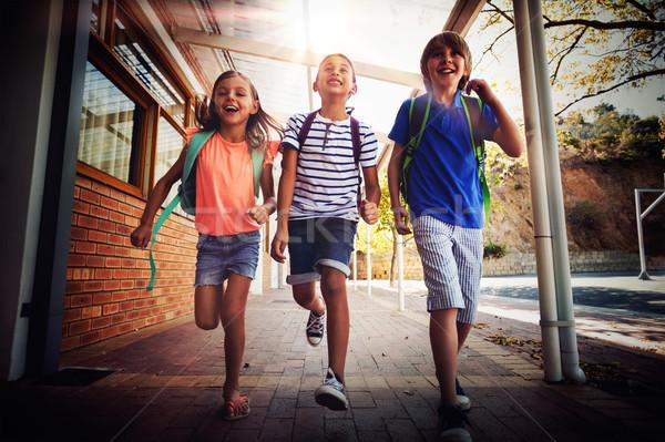 Szczęśliwy szkoły dzieci uruchomiony korytarz student Zdjęcia stock © wavebreak_media