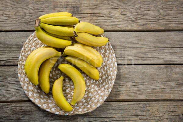 Stock photo: Overhead of fresh bunch of bananas in plate