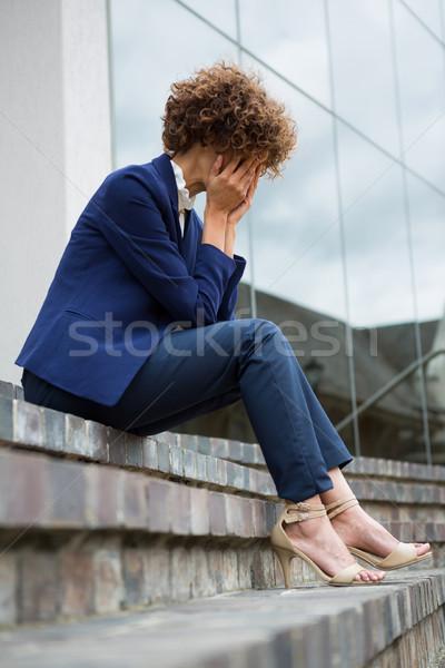 Depressed businesswoman sitting in the premises Stock photo © wavebreak_media