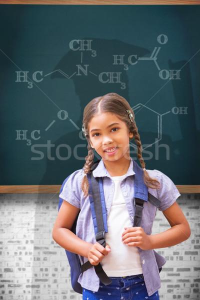 Composite image of cute pupil smiling at camera Stock photo © wavebreak_media