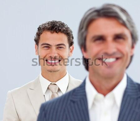 Atrakcyjny ludzi biznesu stałego rząd biały szczęśliwy Zdjęcia stock © wavebreak_media