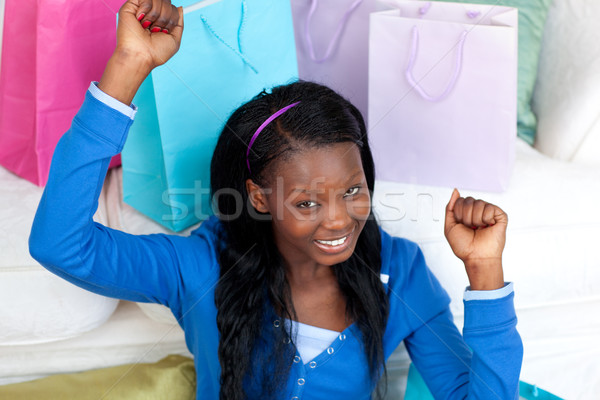 Joyful woman punching the air in celebration after shopping  Stock photo © wavebreak_media