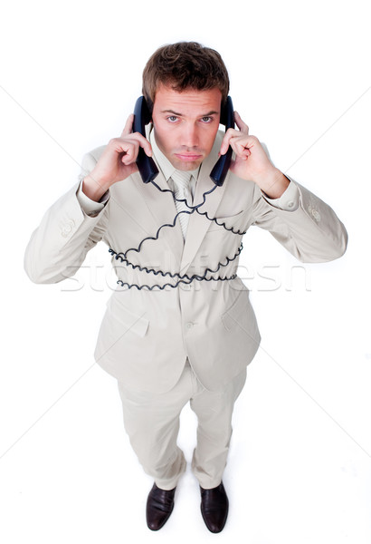 Tired businessman tangle up in phone wires Stock photo © wavebreak_media