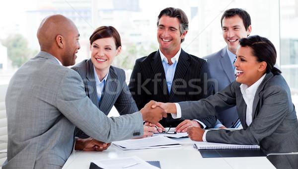 Geschäftsleute Gruß andere Sitzung Hand Stock foto © wavebreak_media