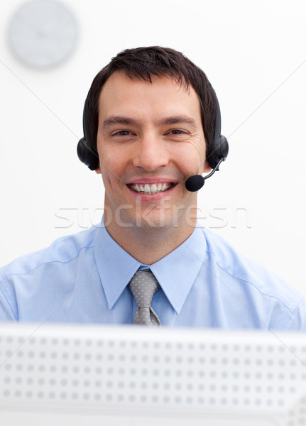 Confident businessman with headset on in a call center Stock photo © wavebreak_media