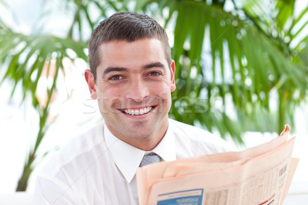 Portrait of a businessman reading a newspaper in workplace Stock photo © wavebreak_media