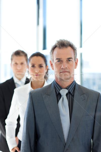 Zakenman leidend business team rij senior business Stockfoto © wavebreak_media