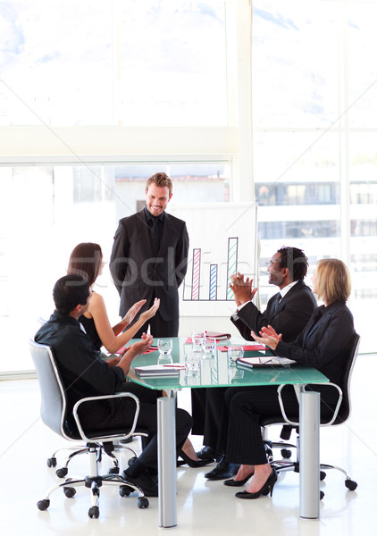 Stock photo: Business people clapping a colleague in a presentation