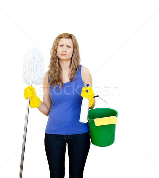 Angry woman against white background with cleaning utensils Stock photo © wavebreak_media