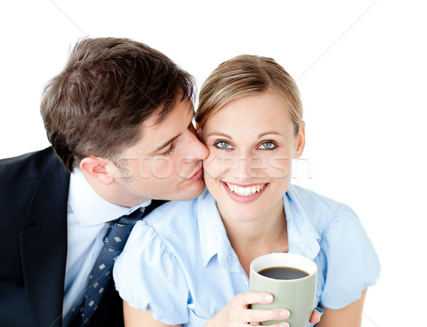 Attentive businessman kissing his girlfriend at her cheek against white background Stock photo © wavebreak_media