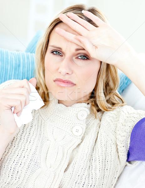 Femme canapé sensation température blanche fond Photo stock © wavebreak_media