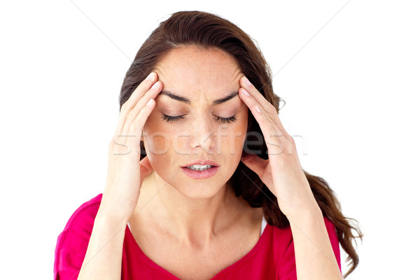 Depressed hispanic woman having a headache against a white background Stock photo © wavebreak_media