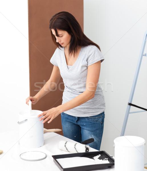 Pretty woman preparing white paint to renovate her bedroom Stock photo © wavebreak_media
