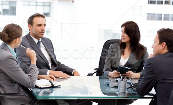 Charyzmatyczny biznesmen mówić partnerów spotkanie pracy Zdjęcia stock © wavebreak_media