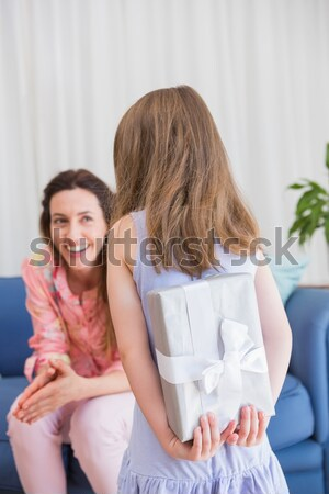 Stock photo: Smiling couple looking at the camera with the present