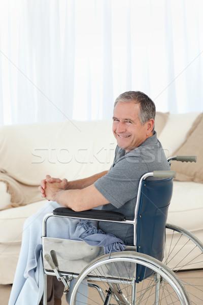Volwassen man rolstoel naar camera home medische Stockfoto © wavebreak_media
