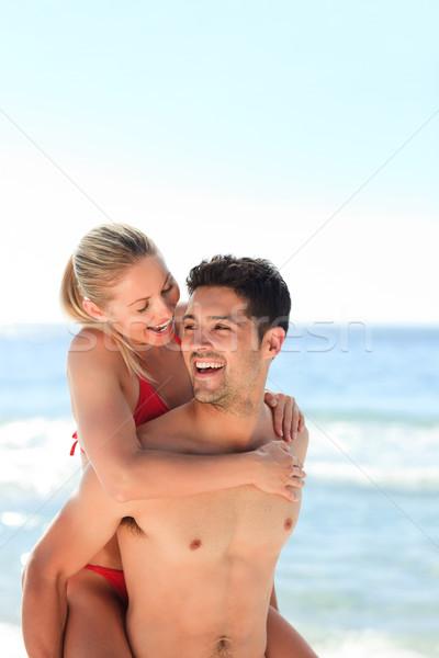 Schönen Mann Freundin huckepack Strand Wasser Stock foto © wavebreak_media