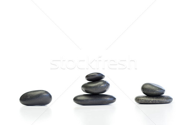 Kinds of piled up pebbles on a white background Stock photo © wavebreak_media