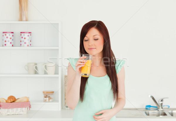 Vonzó nő élvezi üveg narancslé konyha Stock fotó © wavebreak_media