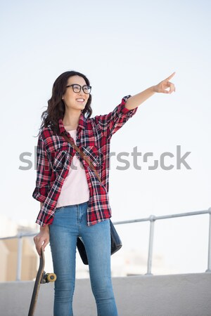 Attractive female posing with books while standing against a white background Stock photo © wavebreak_media