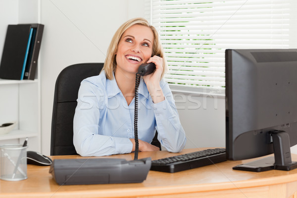 Cheerful businesswoman on phone looking at the ceiling of her office Stock photo © wavebreak_media