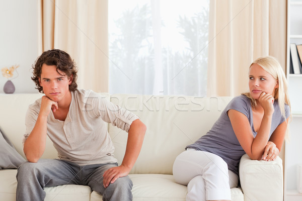 Couple mad at each other sitting on a sofa Stock photo © wavebreak_media