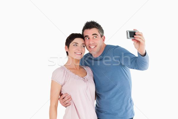 Pár elvesz kép fehér nő kéz Stock fotó © wavebreak_media