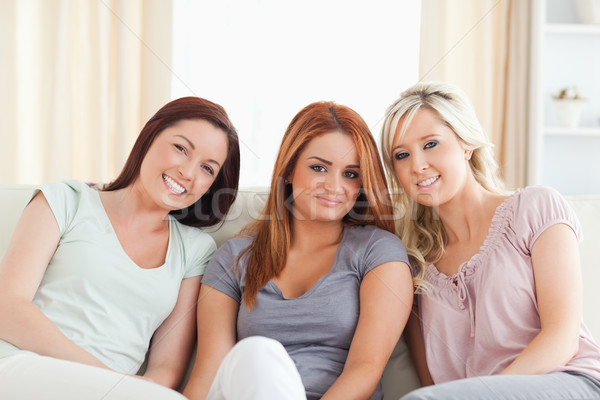 Cute women lounging on a couch Stock photo © wavebreak_media