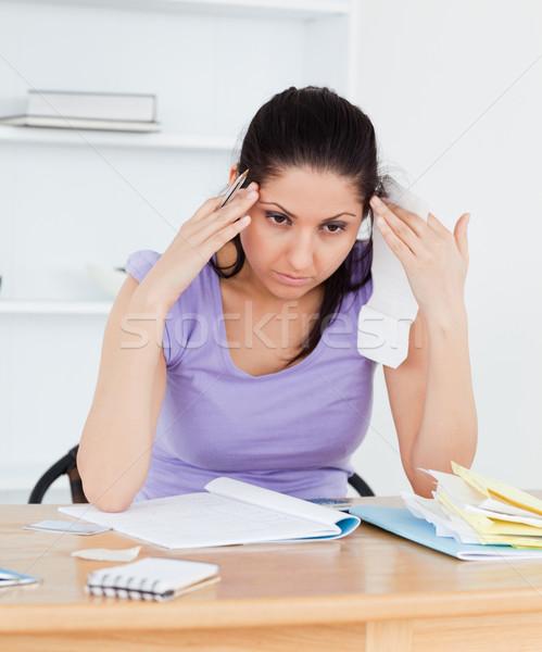 Młodych rachunkowości kobieta głowy papieru pracy Zdjęcia stock © wavebreak_media