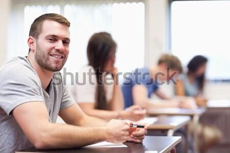 Lächelnd junger Mann posiert Klassenzimmer Frau glücklich Stock foto © wavebreak_media