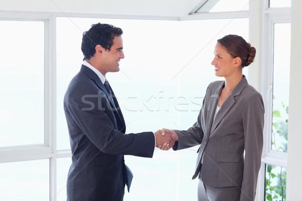 вид сбоку молодые партнера рукопожатием бизнеса компьютер Сток-фото © wavebreak_media