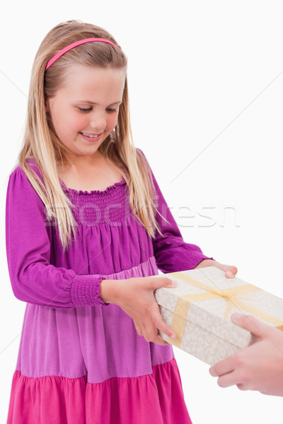 Portrait of a girl receiving a present against a white background Stock photo © wavebreak_media