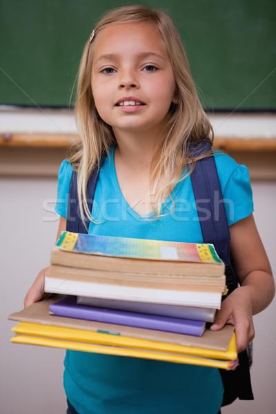 Retrato feliz colegiala libros aula Foto stock © wavebreak_media