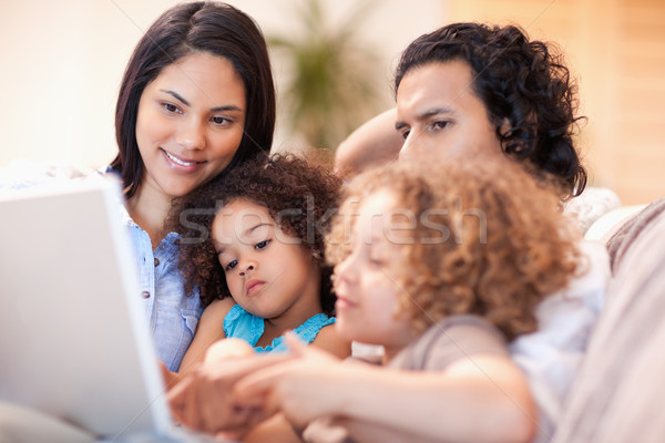 Happy young family using laptop together Stock photo © wavebreak_media