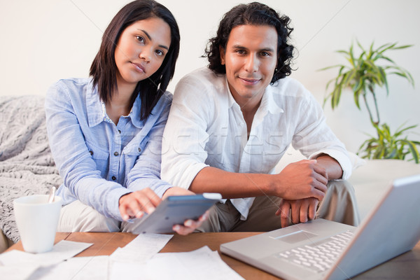 Young couple paying their bills online Stock photo © wavebreak_media