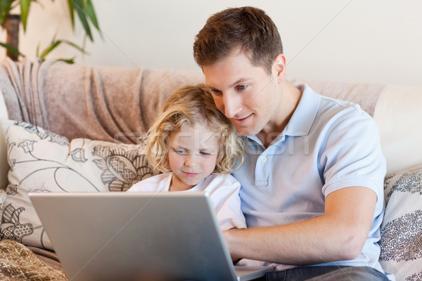 Father and son surfing the internet on the sofa Stock photo © wavebreak_media