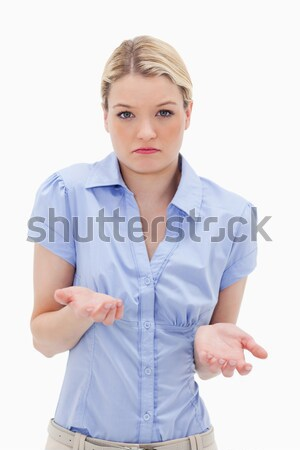 Clueless young woman against a white background Stock photo © wavebreak_media