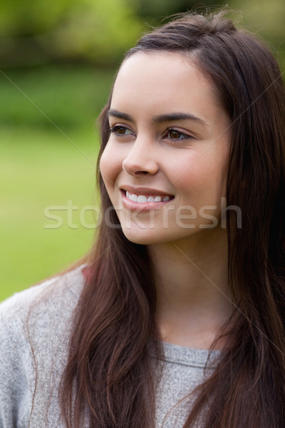 Thoughtful young woman standing in the countryside while looking away Stock photo © wavebreak_media