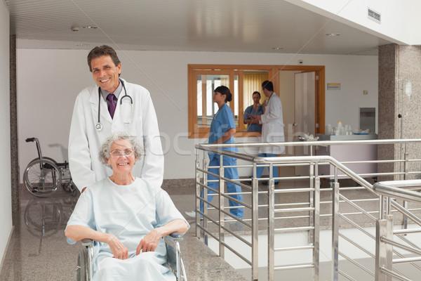 смеясь старуху сидят коляске врач Сток-фото © wavebreak_media