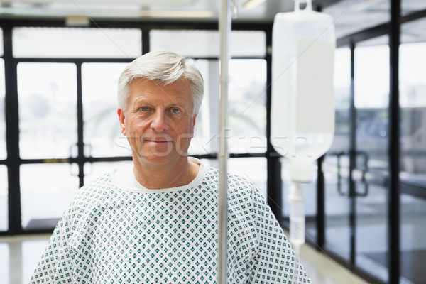 Patient standing in the corridor of the hospital with IV drip Stock photo © wavebreak_media