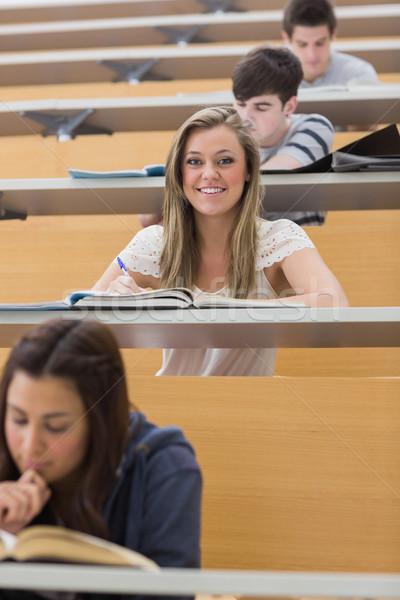 öğrenci oturma ders salon gülen Stok fotoğraf © wavebreak_media