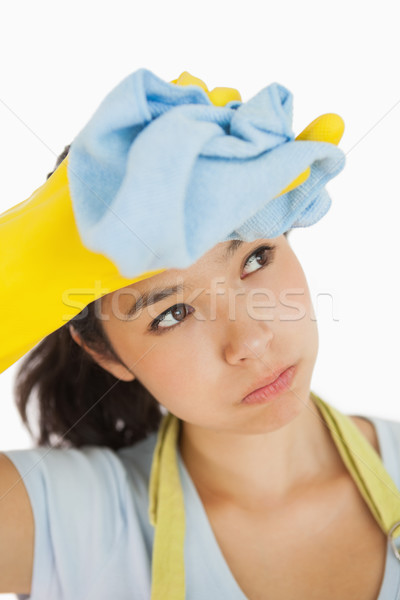 Woman wiping her brow wearing rubber gloves and an apron Stock photo © wavebreak_media